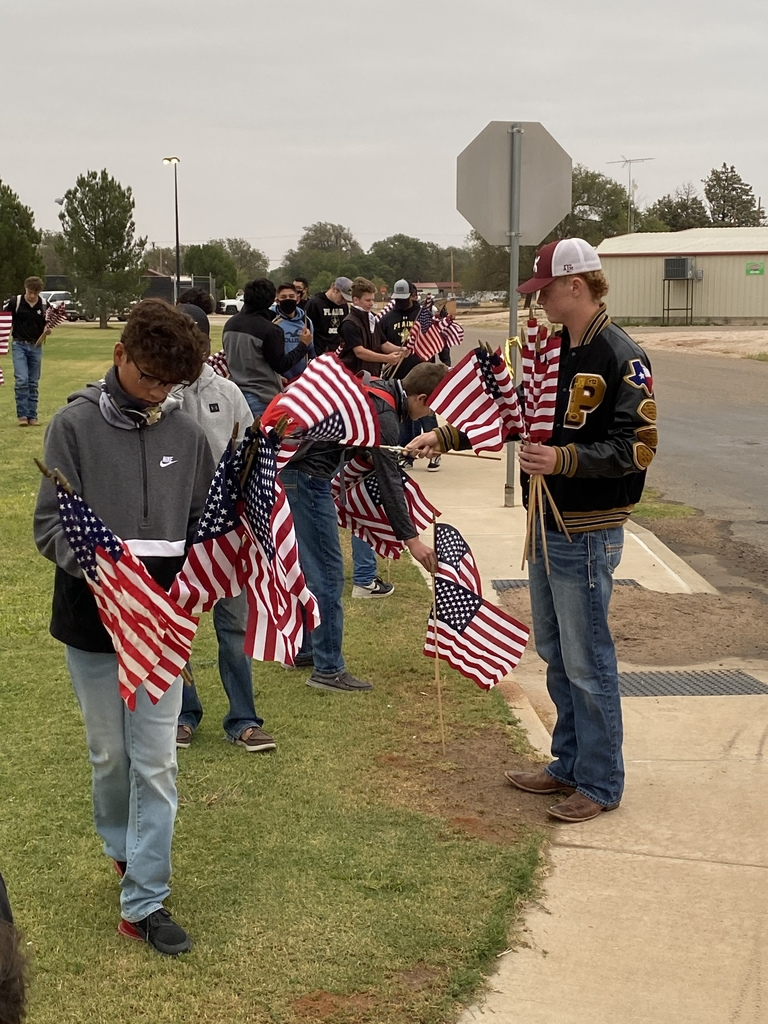 Plains Cowboys putting up flags in remembrance of 9-11